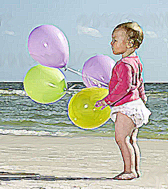 baby with ballons on beach